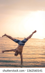 Indonesia, Banten in Tanjung Lesung Island, 22 Juny 2019, One arm Handstand in Sunset
