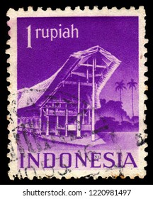 INDONESIA - CIRCA 1949: A stamp printed in the Indonesia, shows Tongkonan, traditional ancestral house Torajan people in South Sulawesi, Indonesia, circa 1949