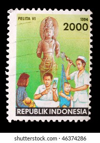 INDONESIA - CIRCA 1994: A stamp shows image of infants being weighed in a hosptial, circa 1994