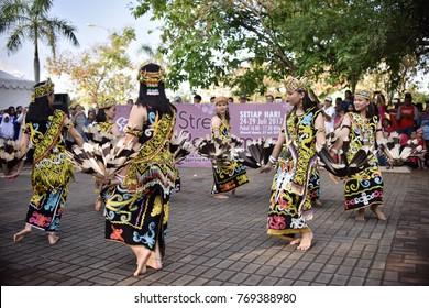 Indonesia, East Borneo, Kutai Kartanegara, Tenggarong, Erau and International Folk Arts Festival 2017. Dayak dance in street performance event