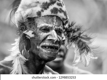 INDONESIA, IRIAN JAYA, ASMAT PROVINCE, AMANAMKAY VILLAGE - MAY 22: The Portrait Asmat warrior with a traditional painting and coloring on a face. Black and white. On May 22, 2017  Amanamkay Village, A