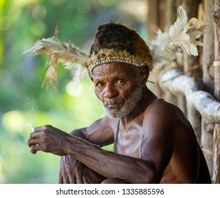 INDONESIA, IRIAN JAYA, ASMAT PROVINCE, AMANAMKAY VILLAGE - 13 JUNE 2016: The Portrait Asmat warrior with a traditional painting and coloring on a face. On June 13, 2016 Amanamkay Village, Asmat provin