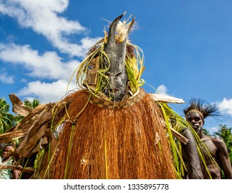 INDONESIA, IRIAN JAYA, ASMAT PROVINCE, AMANAMKAY VILLAGE - 13 JUNE 2016: Warriors of the Asmat tribe with spears in battle paint dancing a ritual dance of spirits. On June 13, 2016 Amanamkay Village,