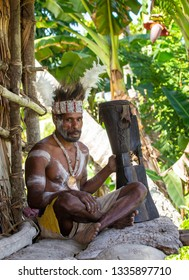 INDONESIA, IRIAN JAYA, ASMAT PROVINCE, AMANAMKAY VILLAGE - 13 JUNE 2016: Warrior of the Asmat tribe in war paint and with a drum in his hands. On June 13, 2016 Amanamkay Village, Asmat province, Indon