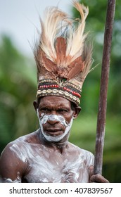 INDONESIA, IRIAN JAYA, ASMAT PROVINCE, JOW VILLAGE - JUNE 12: The Portrait Asmat warrior with a traditional painting and coloring on a face. On June 12, 2012  Jow Village, Asmat province, Indonesia
