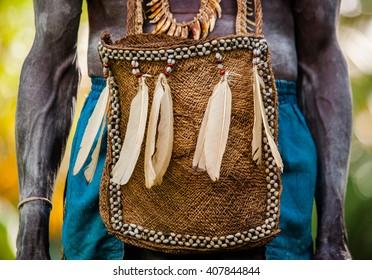 INDONESIA, IRIAN JAYA, ASMAT PROVINCE, JOW VILLAGE - JUNE 12: Traditional bag Asmat tribe warrior. On June 12, 2012  Jow Village, Asmat province, Indonesia
