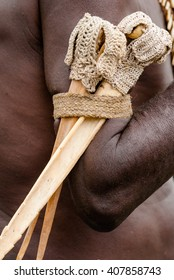 INDONESIA, IRIAN JAYA, ASMAT PROVINCE, JOW VILLAGE - JUNE 12: Traditional bone knife in the hand of a warrior tribe Asmat. On June 12, 2012  Jow Village, Asmat province, Indonesia