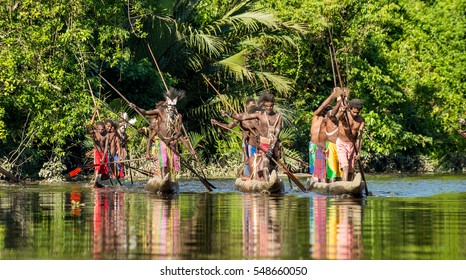 INDONESIA, IRIAN JAYA, ASMAT PROVINCE, JOW VILLAGE - MAY 23: Canoe war ceremony of Asmat people. Headhunters of a tribe of Asmat . New Guinea Island, Indonesia. May 23, 2016