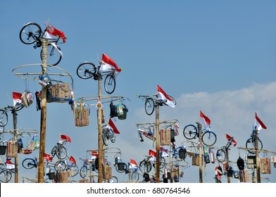Indonesia, Jakarta - August 18, 2014: Areca Nut Tree Climbing Competition or Panjat Pinang competition in the Indonesia Independence Day celebrate on August 17.