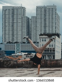 Indonesia, Jakarta City in place Rooftop,on 20 Janury 2019, one arm handstand with a view of the tall building behind it
