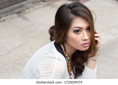 INDONESIA, JAKARTA - May 1, 2020: Photographers / Photographic Models - Beautiful faces and sexy expressions, beautiful lips and elegant hairstyles. Unique and attractive outdoor dress photo shoot