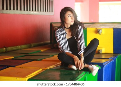 INDONESIA, JAKARTA - May 16, 2020: Photographers / Photography Models - Beautiful, long-haired woman with pirqng color, punk style who is attractive and simple. Colorful indoor shooting. Original