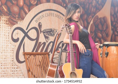 INDONESIA, JAKARTA - May 16, 2020: Photographer / Model Photography - Long-haired and blonde woman who is sexy with a beautiful posture, dressed in a simple and attractive casual. focalist,caffe musik