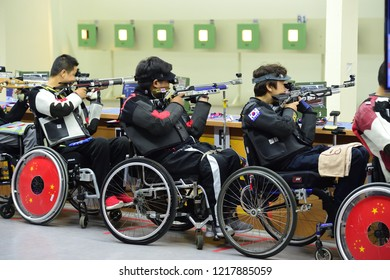 INDONESIA, October 6-13, 2018 : MANSING WIRAPHON(center) Gold Medal from Thailand in action during Shooting para  R1 - Men's 10M Air Rifle Standing - SH1 in Asian Para Games 2018 at JAKARTA, INDONESIA