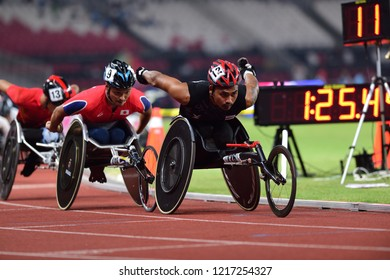 INDONESIA, October 6-13, 2018 : PRAWAT WAHORAM  (Black shirt ,Red helmet) Gold Medal from Thailand in action during Wheelchair racing Men's 5000M T53/54 in Asian Para Games 2018 in JAKARTA, INDONESIA