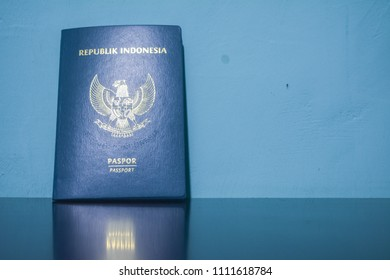 indonesia passport with a blue toscha background