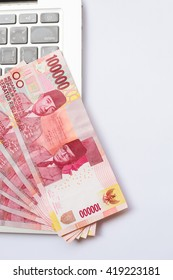 Indonesia Rupiah currency on laptop