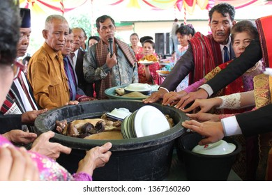 INDONESIA, SAMOSIR ISLAND - NOVEMBER 12, 2017: A traditional weeding of Bataknese with local culture at Samosir Island, the meet and doing some ceremonial. with environment around the party