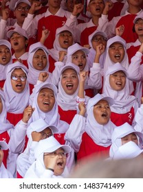 Indonesia, Surabaya - Aug 17 2019: Surabaya city, Gubernur Suryo Street, on the ceremony of independence day. Choirs sing a National Anthem with enthusiasm on their faces