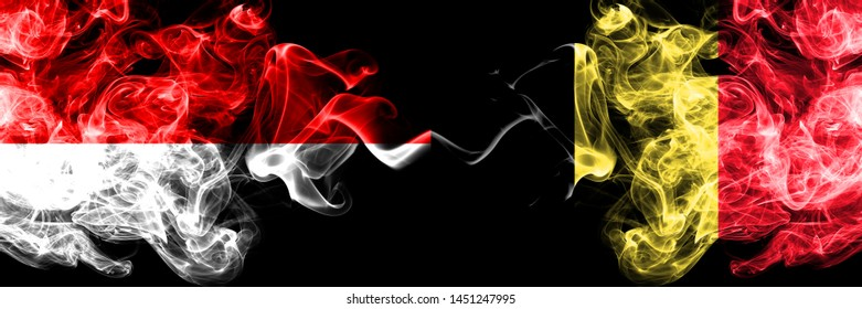 Indonesia vs Belgium, Belgian smoky mystic flags placed side by side. Thick colored silky smoke flags of Indonesia and Belgium, Belgian