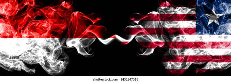 Indonesia vs Liberia, Liberian smoky mystic flags placed side by side. Thick colored silky smoke flags of Indonesia and Liberia, Liberian