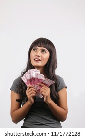 indonesia women happy with holding rupiah money isolated on white background.