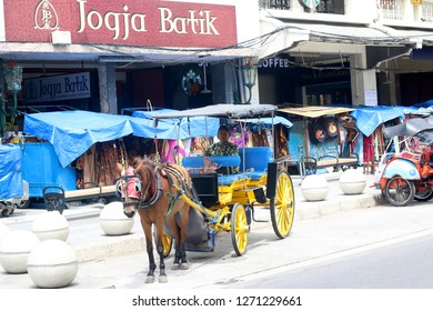 Indonesia, Yogyakarta, December 28, 2018: A coachman is waiting for passengers in the morning
