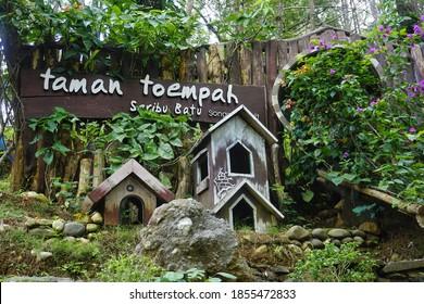 Indonesia, Yogyakarta - November 15, 2020: A tourist spot called Wisata Seribu Batu Songgo Langit. presenting the beauty of pine forests( hutan pinus) in the hills. there is a hobbit house garden.