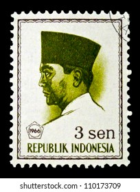 """INDONESIA-CIRCA 1966: A stamp printed in Indonesia shows a portrait of Suharno - first President of Indonesia (1945 - 1967), without the inscription, from the series """"President Suharno"""", circa 1966"""