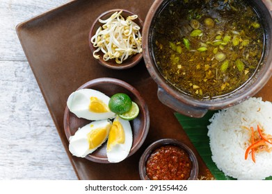 Indonesian beef soup served with bean spouts, rice, eggs and sambal.
