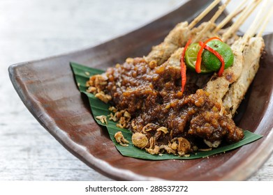 Indonesian chicken sate served with peanut sauce.