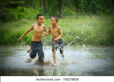 Indonesian children, Boys playing on river,Asia