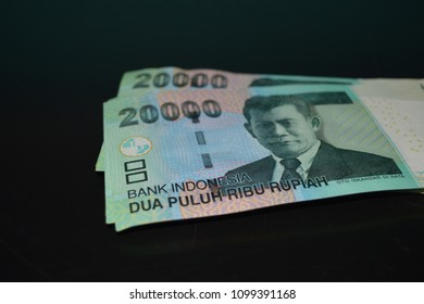 The Indonesian currency IDR 20,000 with black background