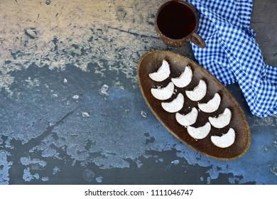 Indonesian famous cookies for celebrating Eid Mubarak / Idul Fitri / Lebaran , Kue kering Putri Salju, crescent shaped cookies coated with powdered sugar