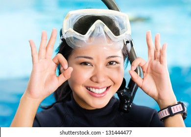 Indonesian female diver with glasses and snorkel in a diving school