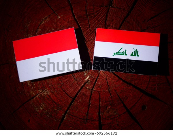 Indonesian flag with Iraqi flag on a tree stump isolated