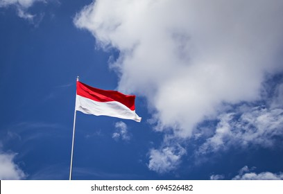 Indonesian Flag, Red and White, with blue sky background