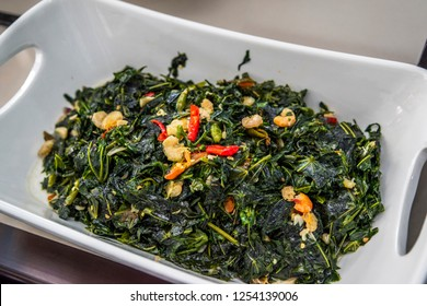Indonesian food sautéed cassava leaves or tumis daun singkong