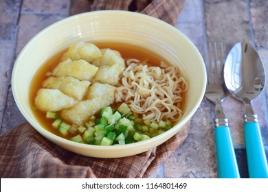Indonesian Food Empek-empek (fried savory fish cake) from Palembang, South Sumatra, Indonesia. Served in sweet sour sauce (cuko) with egg noodles and diced cucumber