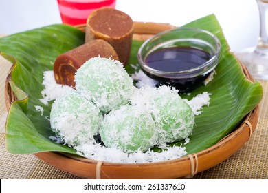 Indonesian Food Klepon with coconut on banana leaf
