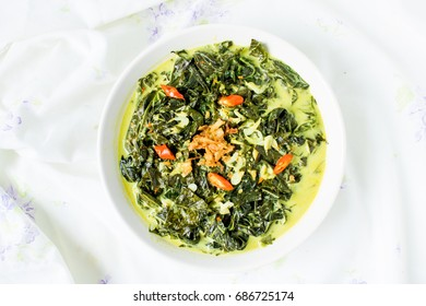 Indonesian food made from Tapioca or cassave leaves cooked with coconut milk / Gulai Daun Singkong