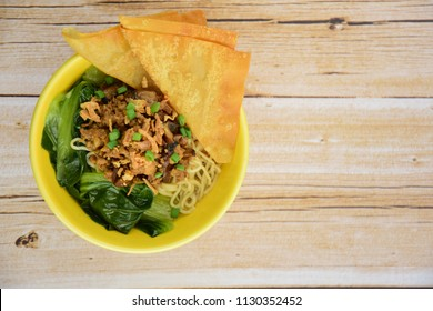 Indonesian food, Mie Ayam, egg noodles with chicken soy sauce, bok choy, fried wonton, fried onion and chives