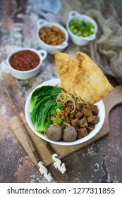 Indonesian food, mie ayam, noodles with chicken and served with meatballs and fried pangsit