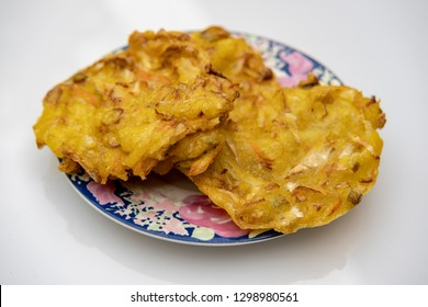 Indonesian fritters or bakwan with white background. Delicious snack.
