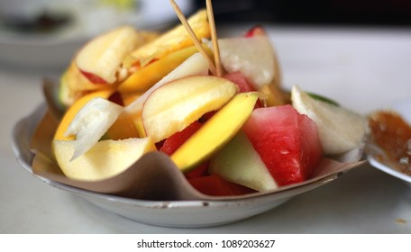 Indonesian fruit salad or rujak. Traditional fruit salad with peanut sauce