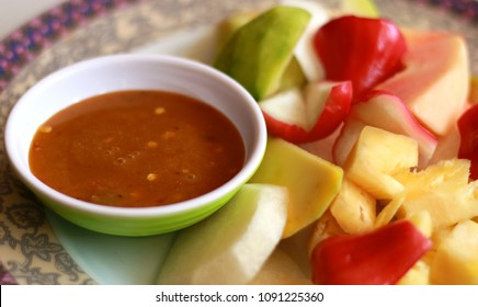 Indonesian fruit salad or rujak. Traditional fruit salad with peanut sauce.