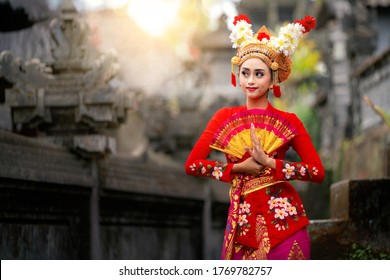 Indonesian girl with traditional costumn dance in bali temple, indonesia