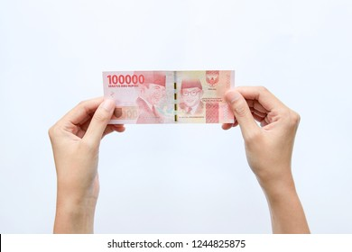 Indonesian hand woman take out showing rupiah money