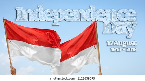 Indonesian independance day  with flag waving over  blue sky background