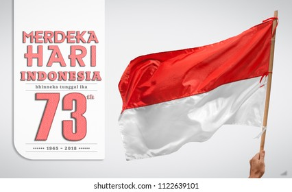 Indonesian independance day  with flag waving over background and indonesian text.